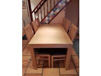 Solid wood extending dining table, seats 6-8, with 6 faux leather chairs extendable £1200 when new