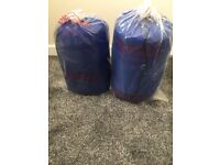 Two brand new single sleeping bags brand new still in wrappers