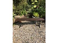 Wrought iron bench with wooden top. Good condition