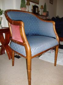 Lloyd Loom style small lounge chair. Cloth rather than rattan.