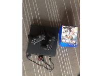 PlayStation 4 slim with 2x controllers and 7x games