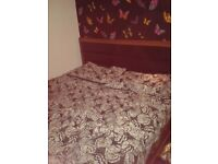 Solid dark wood double bed no matress