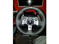 Logitech G920 with shifter and playseat.