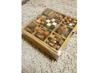 Brand NEW Wooden 9 games and puzzles in a box.
