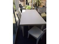 White rubber wood extending table and chairs