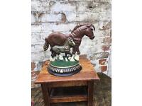 Fun Vintage heavy cast iron door stop featuring a horse and foal