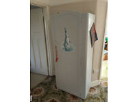 Children's wardrobe with Peter Rabbit picture on front