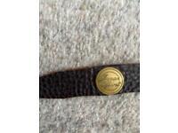 Dark brown leather bracelet.