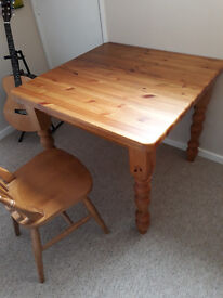 3ft square wood table. Very heavy and well made with 4 traditional wooden chairs.