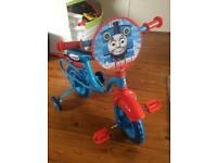 Thomas tank first bike with stabilisers