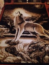 Large rug with wolf on it