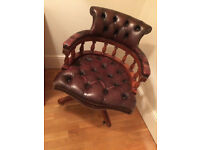 Reproduction Lexterten 'oxblood' leather upholstered Captains Chair Swivel Office Seat