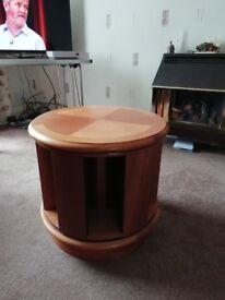 Teak round coffee table with CD storage