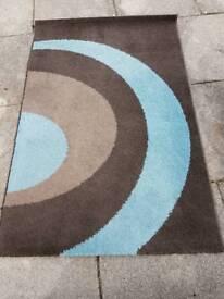 Next brown/blue geometric rug.