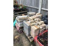 Assortment of Bricks blocks and sand