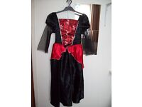 Black/Red Halloween dress, size 11/12. Excellent condition. Worn once.