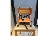 Handysitt portable adjustable high chair seat.