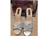 Brand new Gorgeous silver sparkly size 7 high heels