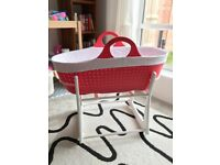 Moba Moses basket, rocking stand, new mattress, mattress covers x2, basket liners and fitted sheets.