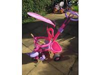 Pink trike with parental handle