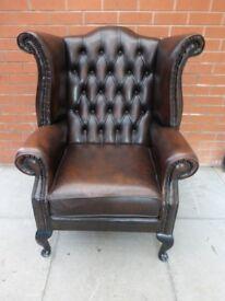 A Brown Leather Chesterfield Queen Ann Armchair