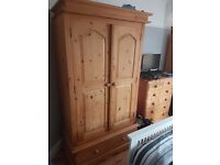 Solid pine wardrobes in three pieces and a chest of drawers