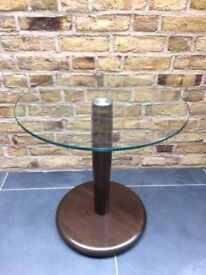 Ercol circular side table with a glass top
