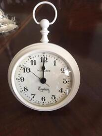 Small metal Newgate antique style table clock with stand