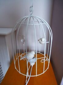 cream metal bird cage lamp with 2 birds