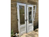 Heavy duty wooden , glass paned double doors . Price shown or best offer