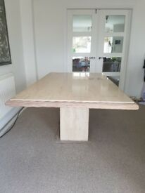 Marble table and 4 chairs in excellent condition.