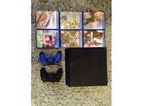 PlayStation 4 500 GB with controllers and games