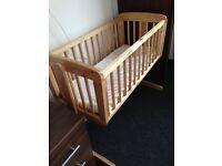 Baby swinging cot
