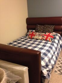 Barely used double TV bed in brown leather