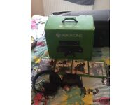 Xbox one boxed 500gb 2 controllers, 4 games and surround sound headset