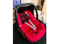 Car seat maxicosi with raincover