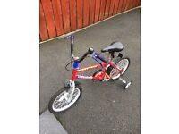 Lovely little bike, complete with stabilisers
