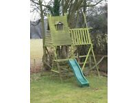 Treetops Treehouse, slide and climbing frame.