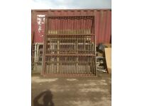 Pair of metal bar workshop gates