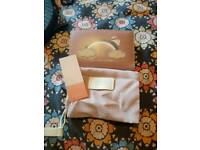 Purse with protective little pink bags