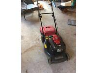 Petrol mountfield lawnmower