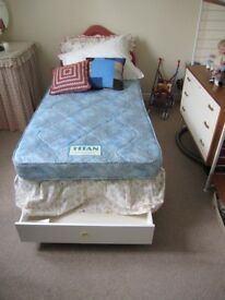 Titan single bed in pristine condition with drawer storage and headboard.
