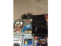 PlayStation 2 bundle and PSP games. £40.