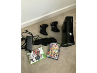 Xbox 360s 250 gb Slim console with kinect and two controllers