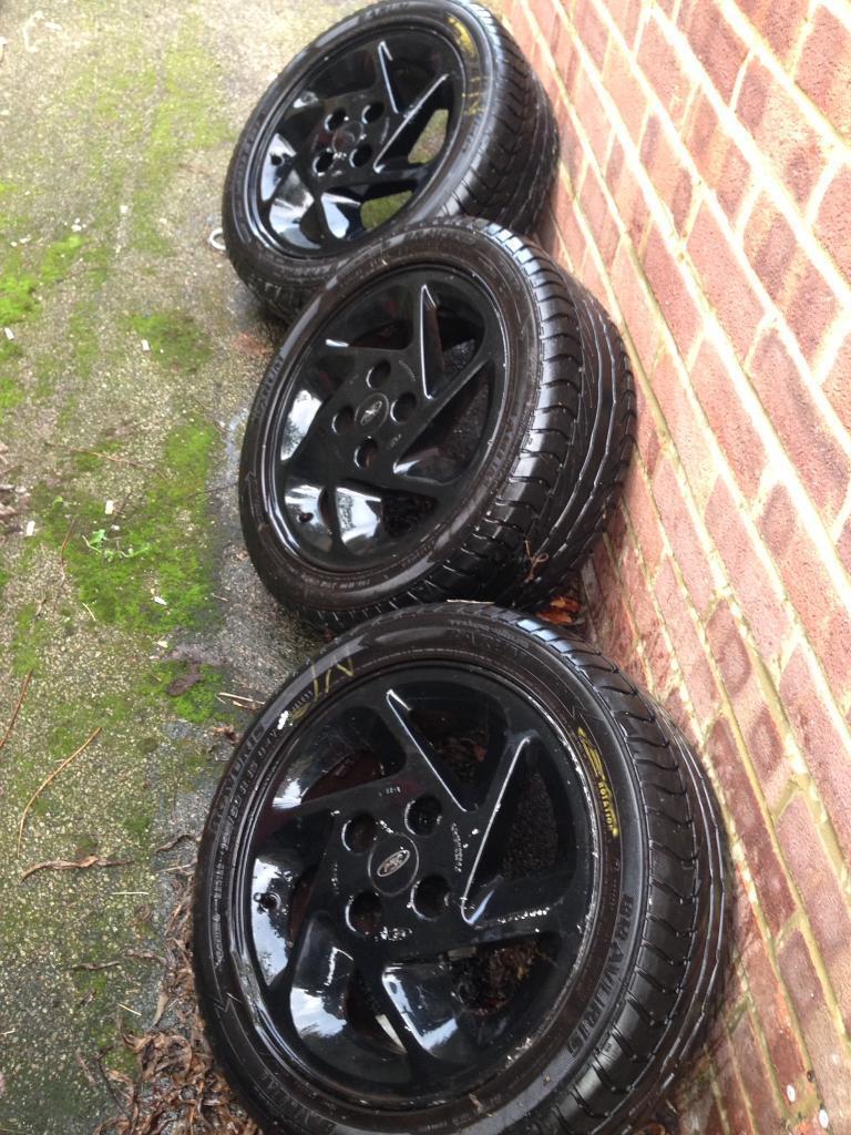 Three black Ford wheels