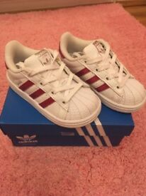 Girls pink adidas superstar trainers