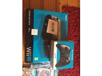 Nintendo Wii U boxed + 9 games + pro controller + Wii controller