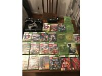 Black Xbox 360 500gb bundle with 23 games and 3 controls