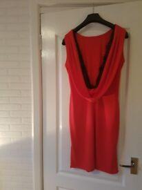 Lovely red knee length dress. Size 12-14. Brand new.