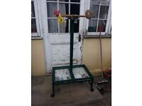 A parrot stand and hamster cage for sale